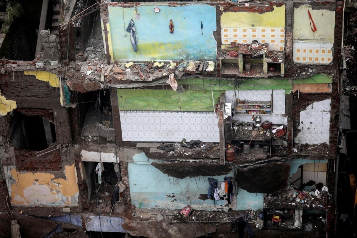 Exposed walls, with household items still intact, are seen in the remains of a three-storey residential building, after a portion of it collapsed, in Bhiwandi on Sept 21, 2020.
