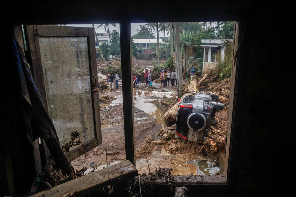 A car is submerged in mud after flash floods swept through Cibuntu Village in Sukabumi, West Java Province, Indonesia, Sept 22, 2020.