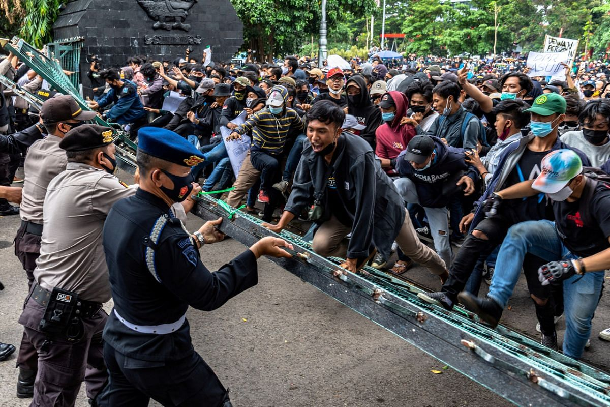 Demonstrators clash with police officers during a protest against the Indonesian government's job creation Bill in Semarang, Central Java, on Oct 7, 2020.