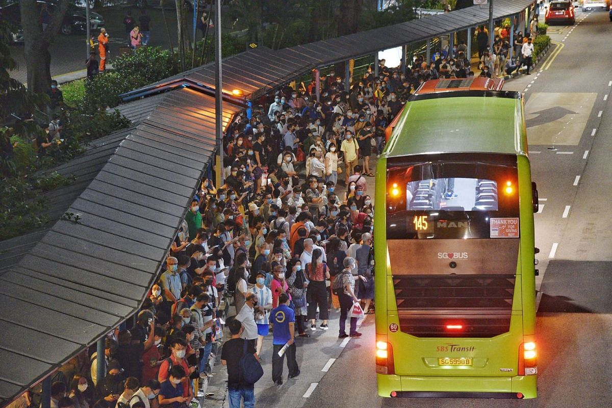 The scene outside Queenstown MRT station on Oct 14, 2020, as train commuters waited to board free bus services. There were no train services on parts of the North-South and East-West lines at about 7pm, and later on the Circle Line at 7.30pm, in what