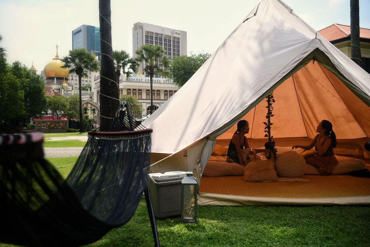 """One of the two tents for the two-day, one-night """"glamping"""" experience at the Malay Heritage Centre – between Dec 15 and 24 – is equipped with two queen-sized beds and a hammock, while another tent provides a space to watch movies with a proje"""