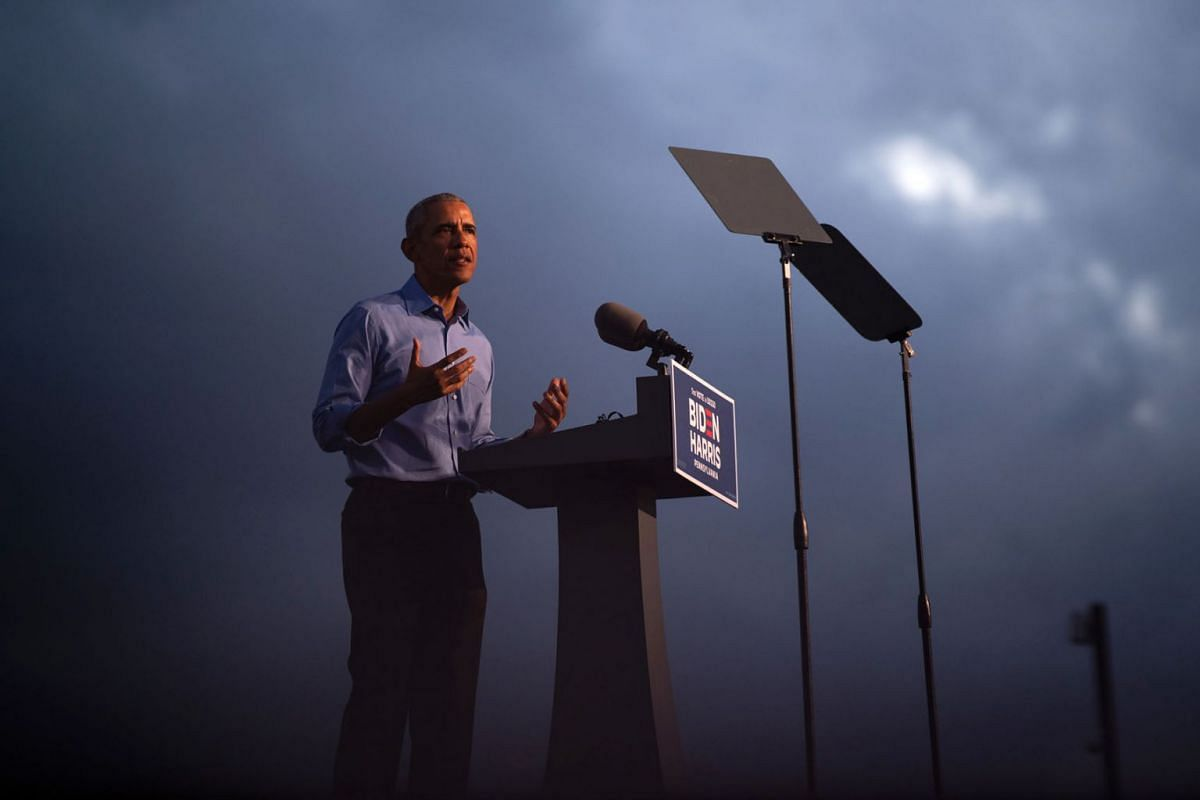 """Former President Barack Obama addresses the crowd during a """"drive-in rally,"""" as he campaigns on behalf of Joe Biden, the Democratic presidential nominee, in Philadelphia, Wednesday, Oct. 21, 2020."""