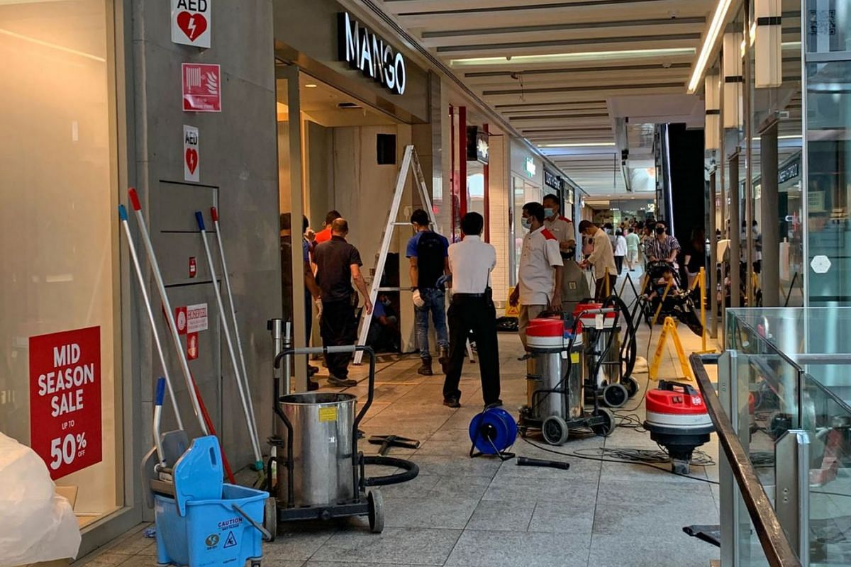 Maintenance work by a tenant caused a water leak from a pipe at Jurong East mall Jem on Oct 20, 2020. The area was cordoned off and about five men were cleaning the area outside the Mango shop.