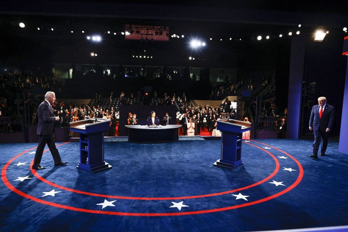 Democratic presidential nominee Joe Biden (L) and US President Donald Trump (R) arrive on stage for the final presidential debate at Belmont University in Nashville, Tennessee, USA, October 22, 2020.