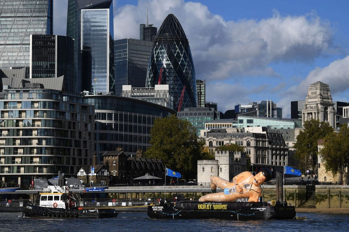"An inflatable man is pulled past a view of the City of London to promote the film ""Borat Subsequent Moviefilm: Delivery of Prodigious Bribe to American Regime for Make Benefit Once Glorious Nation of Kazakhstan"" in London, Britain, October 22, 2020."