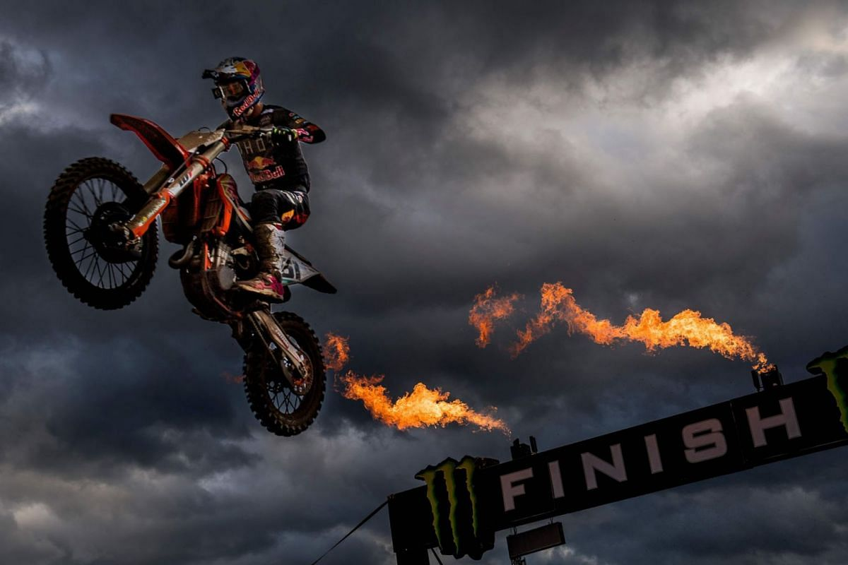 Spanish Jorge Prado Garcia celebrates as he crosses the finish line to win the motocross MXGP Grand Prix, 14th (out of 18) race of the FIM Motocross World Championship, on October 21, 2020 in Lommel.