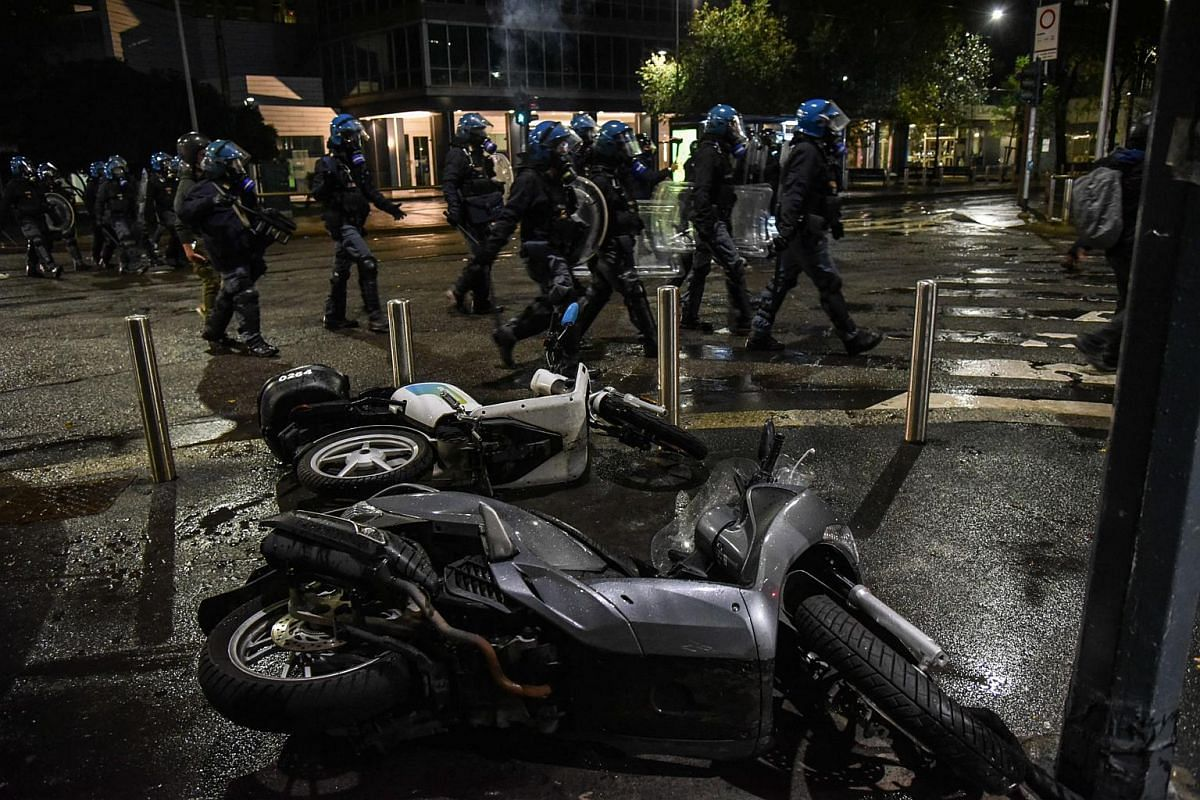 Clashes between demonstrators and police during the protest against the measures implemented to stop the spread of the Covid-19 pandemic in Milan, Italy, on Oct 26, 2020.