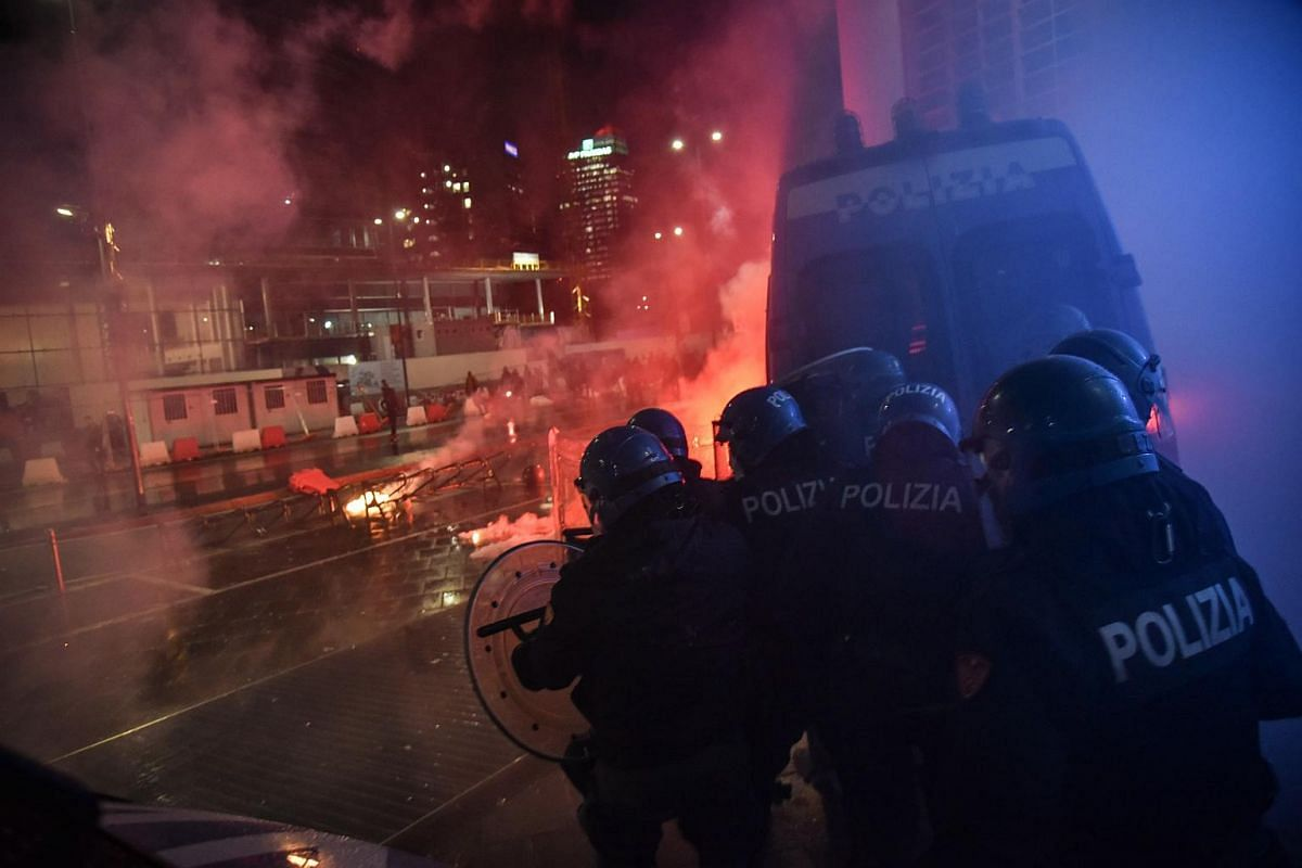Clashes between demonstrators and police during the protest against the measures implemented to stop the spread of the Covid-19 pandemic by the Government in Milan, Italy, on Oct 26, 2020.