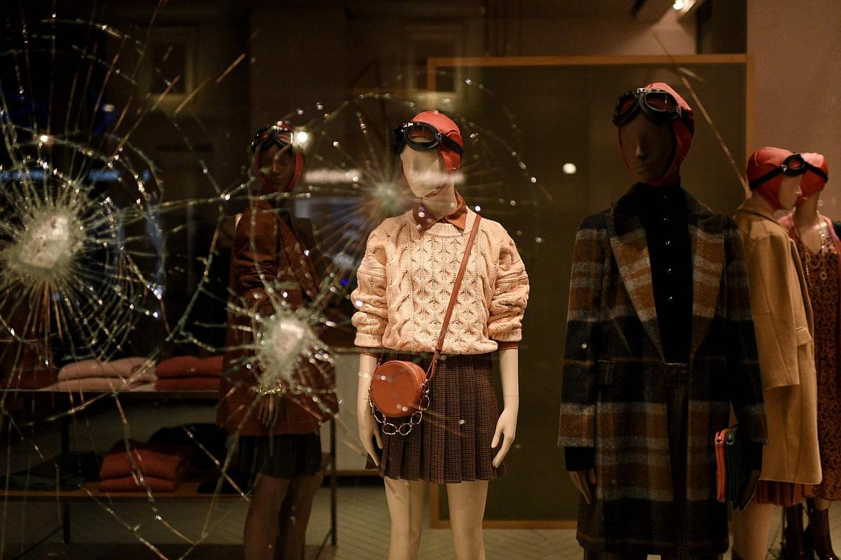 A shattered Gucci store window during a protest of far-right activists against the government restriction measures in downtown Turin, Italy, on Oct 26, 2020.