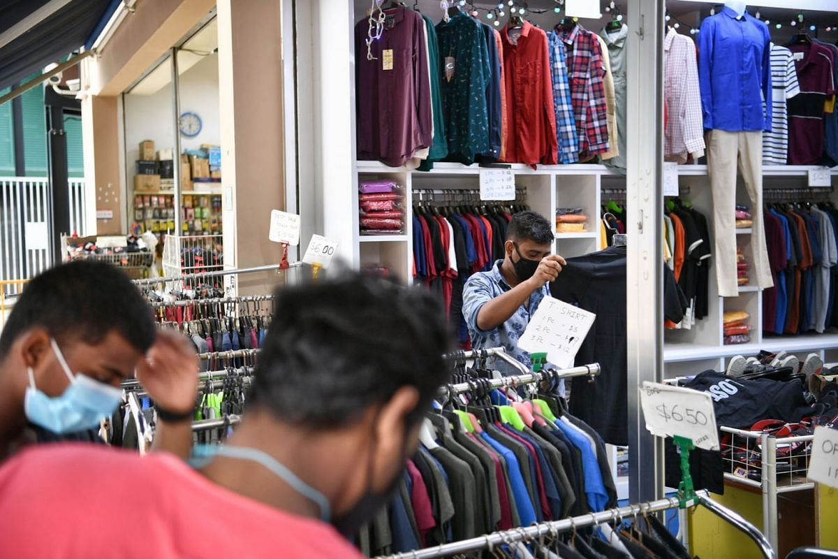 Foreign workers checking out a retail outlet at Tuas South Recreation Centre. They can only visit the recreation centre assigned to their dorms.