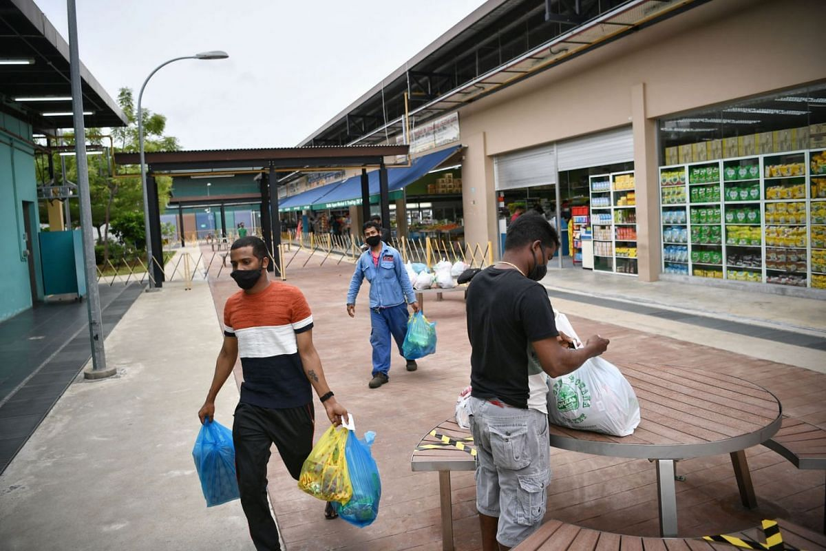 Foreign workers buying necessities from Tuas South Recreation Centre.