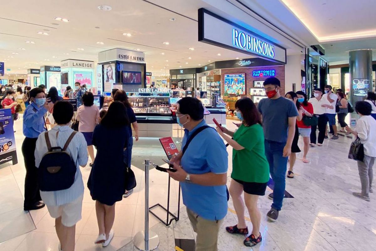 Shoppers queue outside the Robinsons store at Raffles City Shopping Centre on Oct 30, 2020. Robinsons is liquidating its two department stores at The Heeren and Raffles City Shopping Centre.