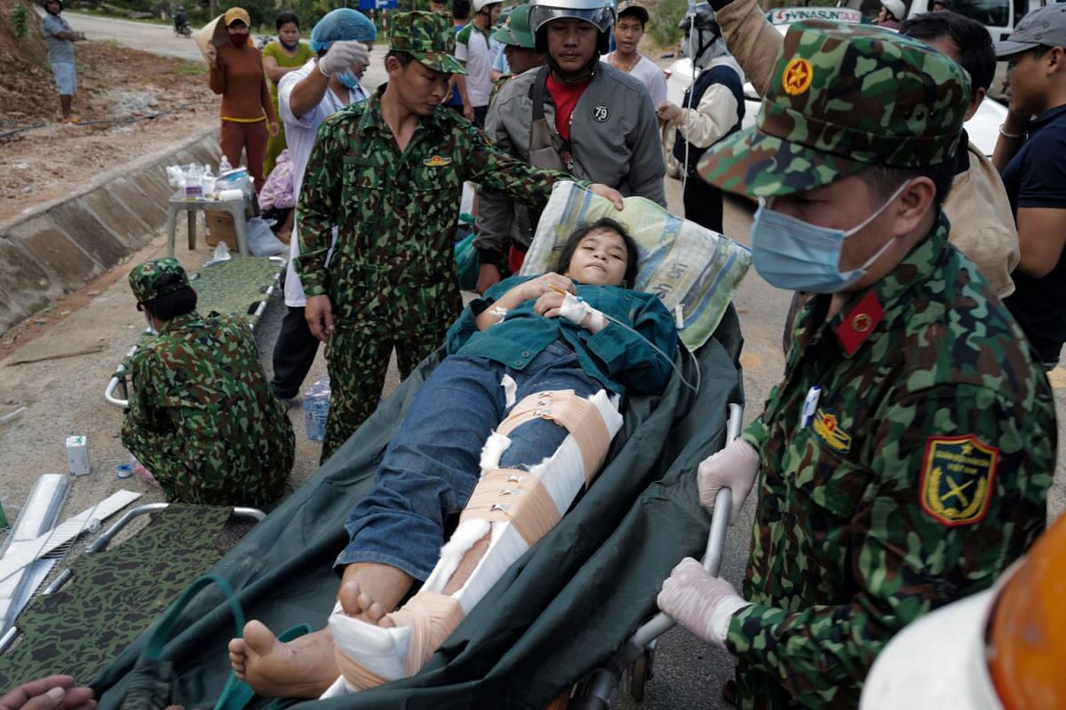 An injured woman rests on a stretcher after she was rescued from a landslide in Tra Leng commune, in Quang Nam province, Vietnam, October 29, 2020.