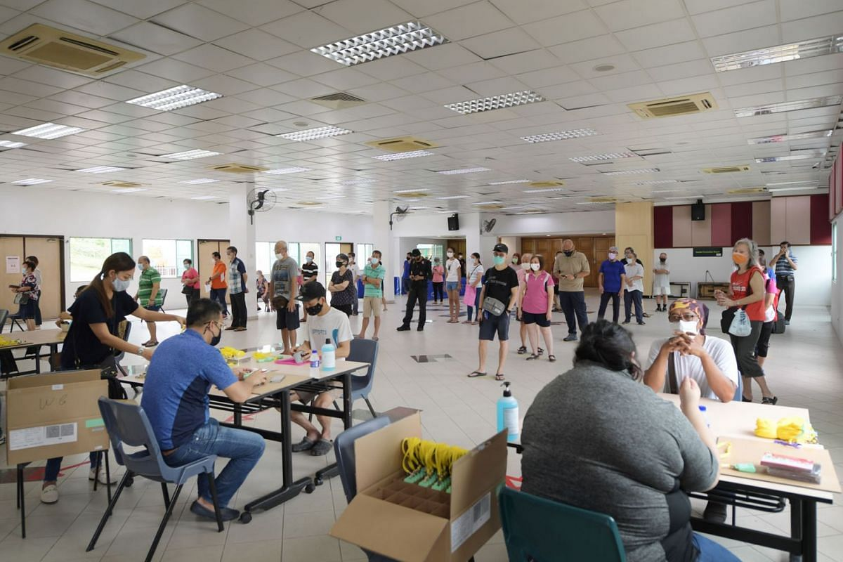 Marsiling residents collecting their TraceTogether tokens at the Marsiling Community Club on October 29, 2020. It is the first collection venue where tokens are available again, after distribution was halted on Wednesday.