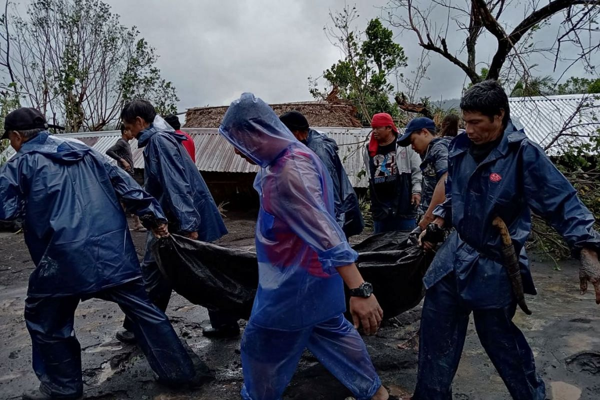 People carry the body of a victim in the aftermath of Typhoon Goni in San Francisco, Guinobatan, Albay province, Nov 1, 2020.