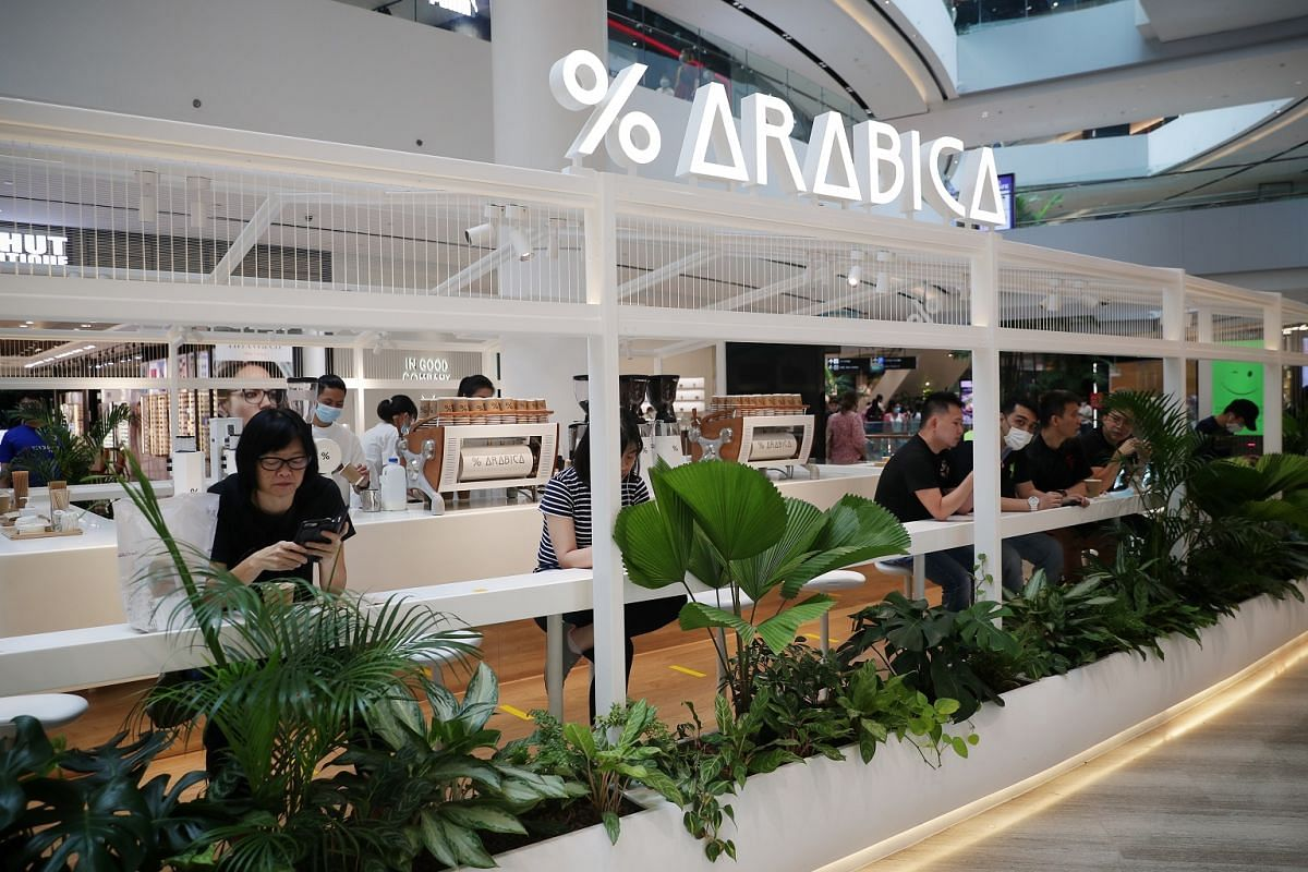Terraces of greenery, new cafe openings, such as Kyoto's  % Arabica (above), and futuristic details, such as robots on patrol, liven up Jewel Changi Airport.