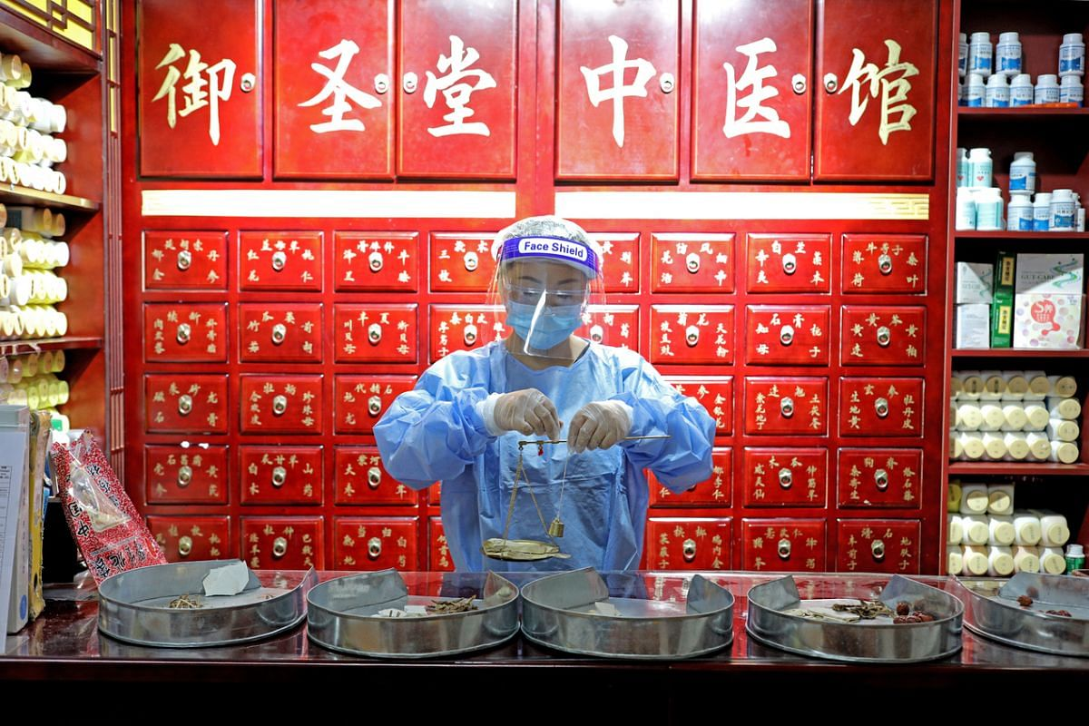 #HEAL: Traditional Chinese medicine practitioner Li Huarong preparing Chinese herbs at Yu Sheng Tang (TCM) Clinic in Bishan on May 5. The pandemic has impacted human health and well-being around the world, and healing the body, mind and spirit will t