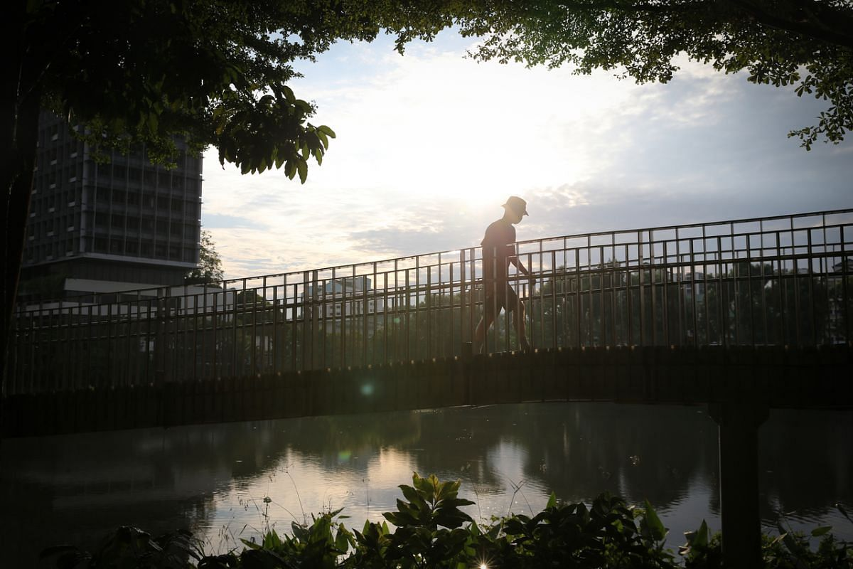 #CHERISH: A man exercises against the backdrop of Yishun Pond, on Sept 15, 2020. After coping with new regulations, restrictions and tighter measures in the efforts to combat the spread of coronavirus, this pandemic year serves to remind us that we s