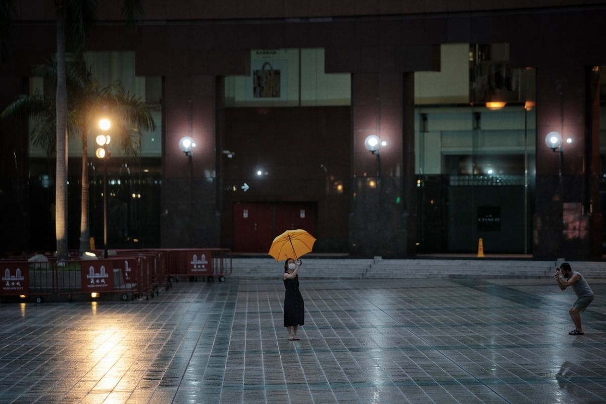#CIRCUIT BREAKER: A couple taking pictures outside Ngee Ann City in an eerily quiet Orchard Road during the circuit breaker on May 1. Implemented from April 7 to June 1, Singapore's nationwide partial lockdown lasted for 56 days as a preventive mea