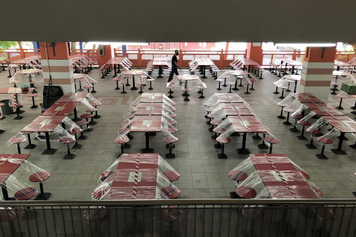#TAPED: Rows of taped-up tables at Chinatown Complex Food Centre on May 6, during the circuit breaker. Public spaces were taped up and marked with crosses like Band-Aids, while stark floor markings reminding people to keep a safe distance when queuei