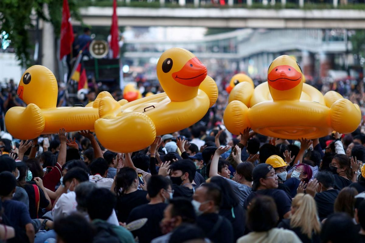 Demonstrators move inflatable rubber ducks during a rally in Bangkok, Thailand, Nov 18, 2020.