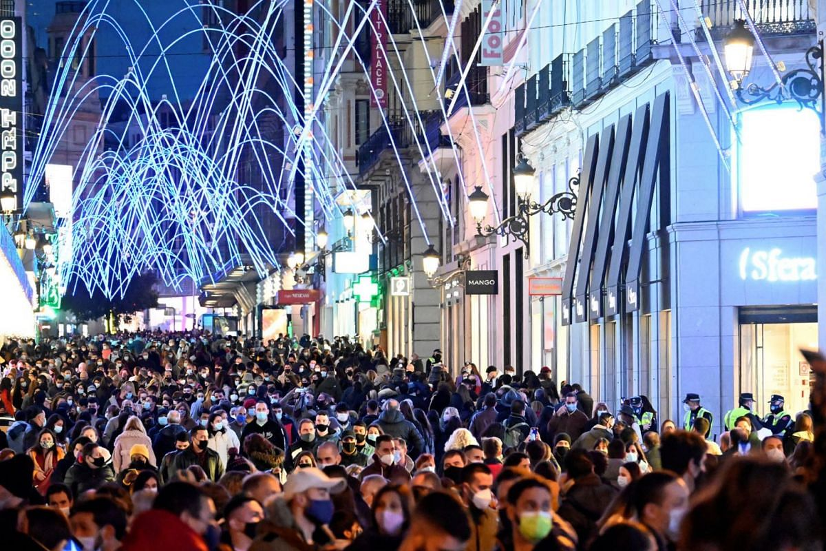 People go Christmas shopping during the first Advent weekend amid the second wave of the coronavirus pandemic, in Madrid, Spain, Nov 29,  2020.