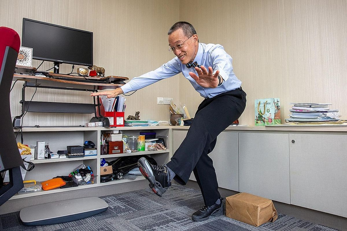 Sengkang General Hospital chief executive Christopher Cheng challenged himself to do the single-leg, sit-to-stand exercise this year.