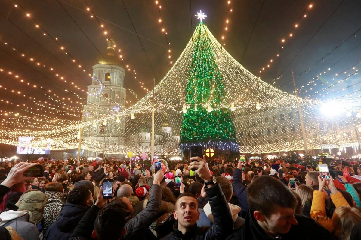 People take part in New Year's Eve celebrations in Kyiv, Ukraine, on Dec 31, 2020.