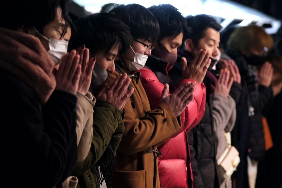People visit Kanda Myojin Shrine to offer New Year prayers in Tokyo on Jan 1, 2021.
