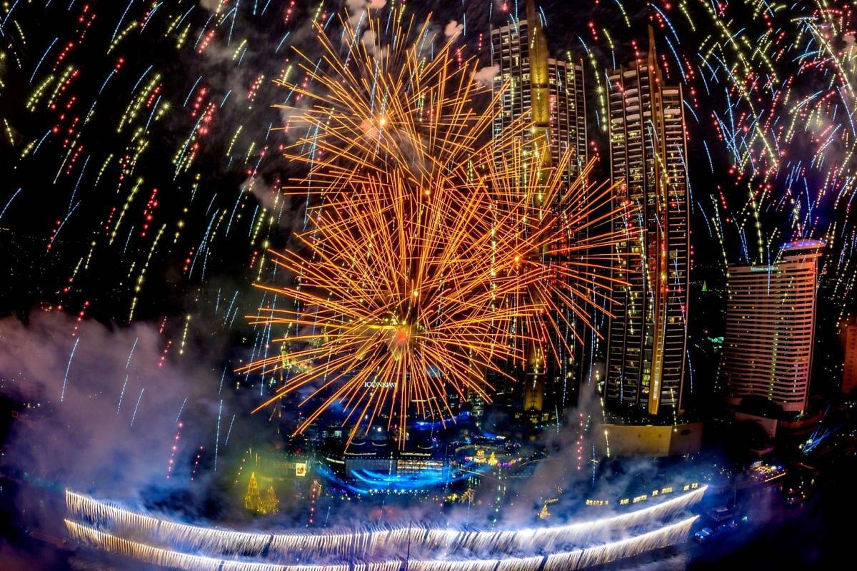 New Year's Eve fireworks erupt over Chao Phraya river during the fireworks show for New Year's Eve in Bangkok on Jan 1, 2021.