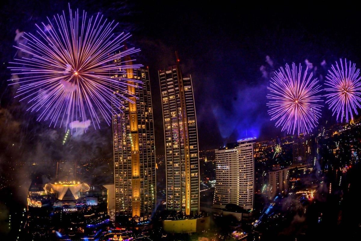 Fireworks erupt over Chao Phraya river during New Year's Eve celebrations in Bangkok on Jan 1, 2021.