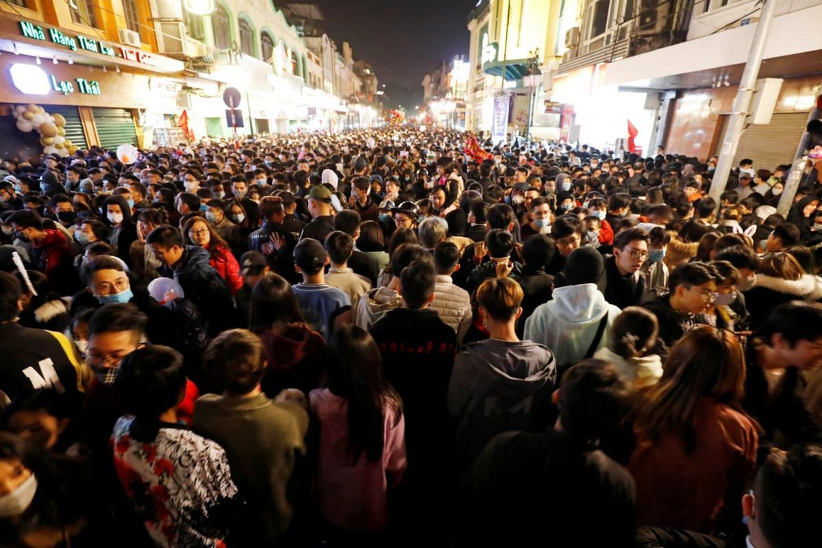 People gather on a street during New Year's Eve celebrations in Hanoi on Jan 1, 2021.