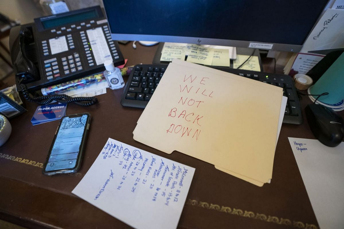 A view of a note left by a supporter of US President Donald J. Trump on the desk of US House Speaker Nancy Pelosi, after supporters of US President Donald J. Trump breached the US Capitol security in Washington, DC, USA, Jan 6, 2021.