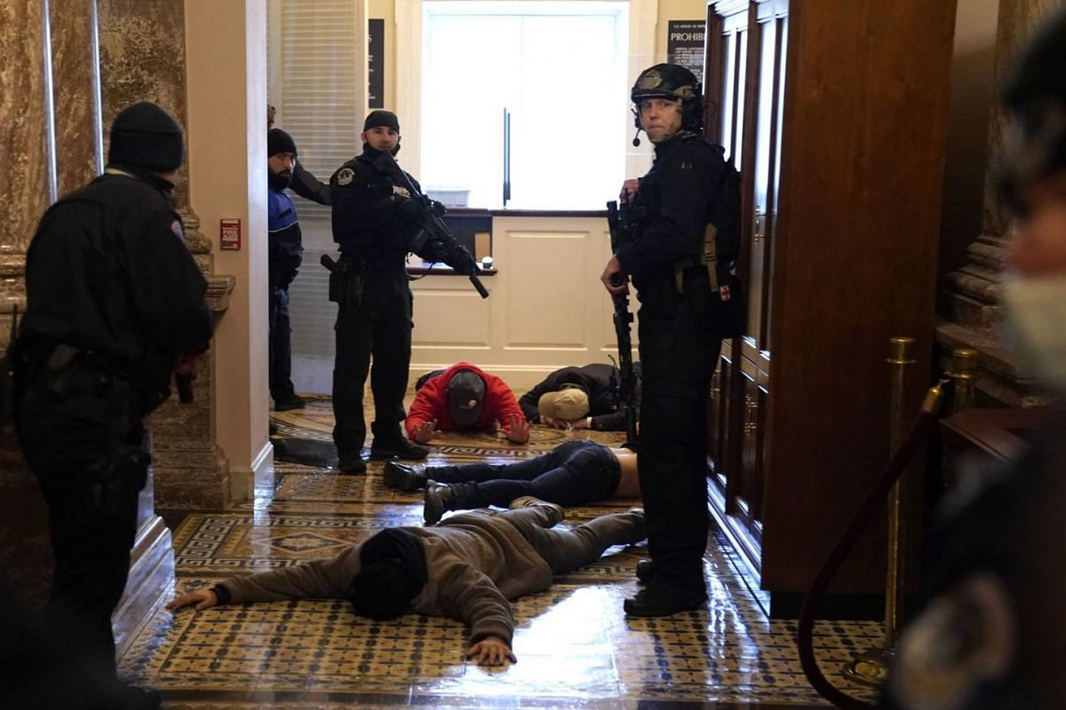 U.S. Capitol Police detain protesters outside of the House Chamber during a joint session of Congress on Jan 6, 2021, in Washington, DC.