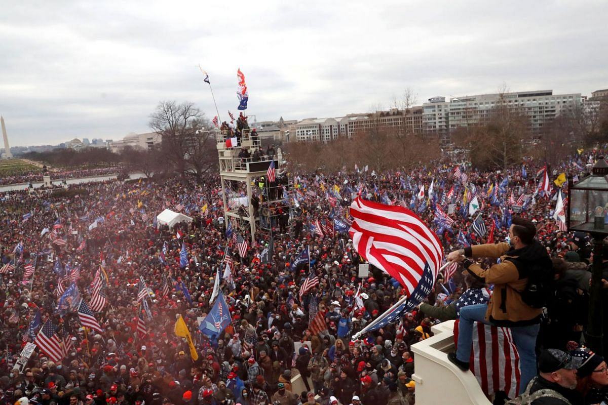 Pro-Trump protesters clash with Capitol police at a rally to contest the certification of the 2020 U.S. presidential election results by the US Congress, at the US Capitol Building in Washington, US Jan 6, 2021.