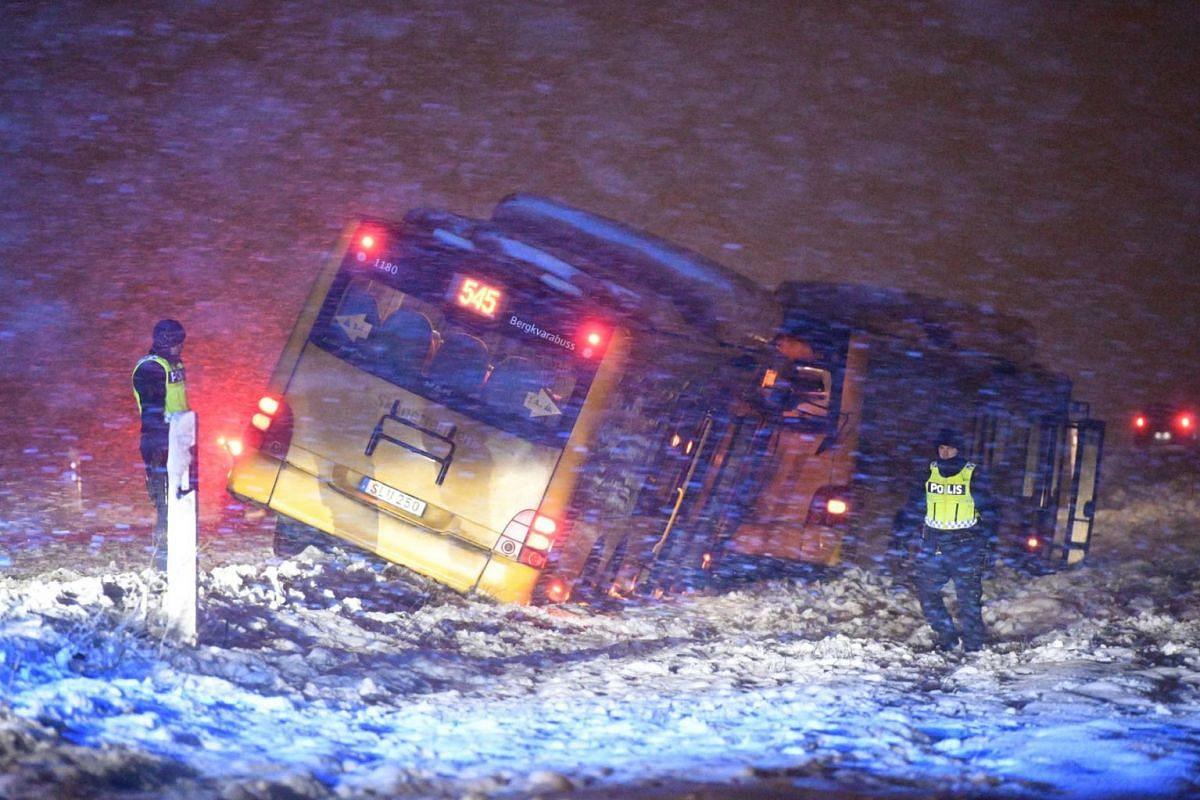Police at the scene of a traffic accident including two buses, due to heavy snowfall, north of Kristianstad, Sweden, Jan 13, 2021.