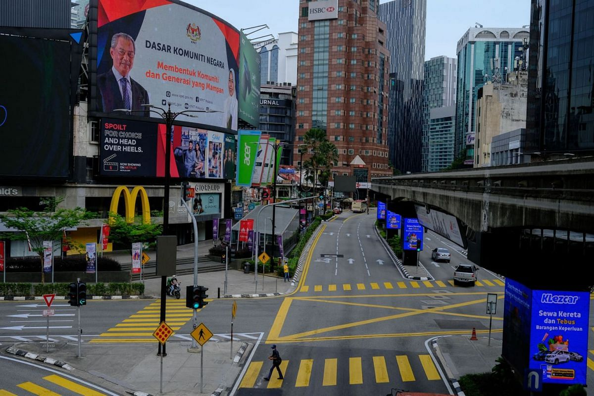 Vehicles travel along a near-empty road during a nationwide state of emergency in Kuala Lumpur, Malaysia, on Jan,13, 2021.