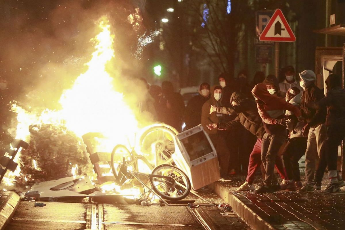Rioters set a barricade on fire demanding justice for Ibrahim, in Brussels, Belgium, Jan 13, 2021. The 23-year-old man died on Jan 9 in a hospital after police brought him there about one hour after his arrest in Brussels North police zone.