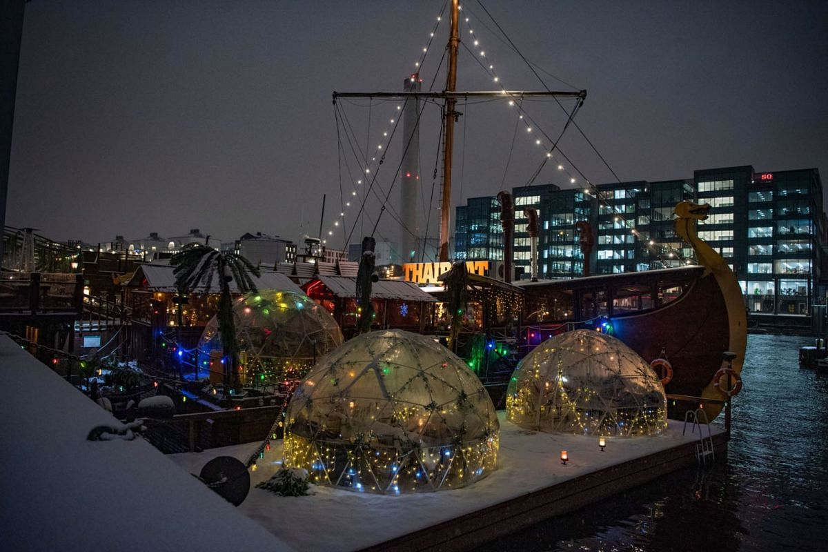 The Thaiboat quayside restaurant offers heated igloos for guests, in the Sodermalm area of Stockholm, Sweden, Jan 13, 2021.