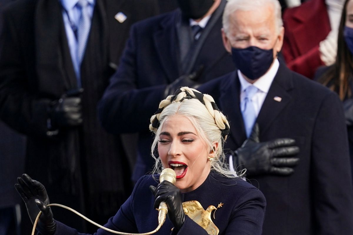 Lady Gaga sings the US National Anthem during the inauguration ceremony.