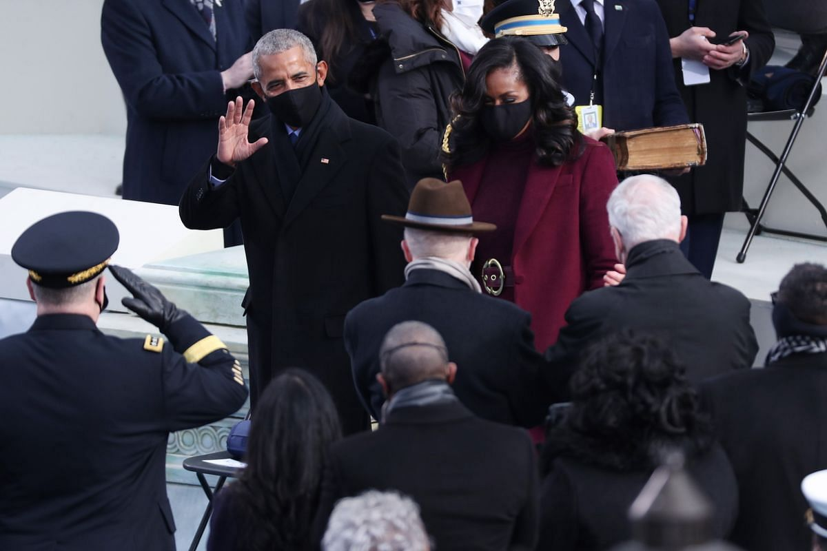 Former US President Barack Obama and his wife Michelle arrive for the inauguration ceremony.