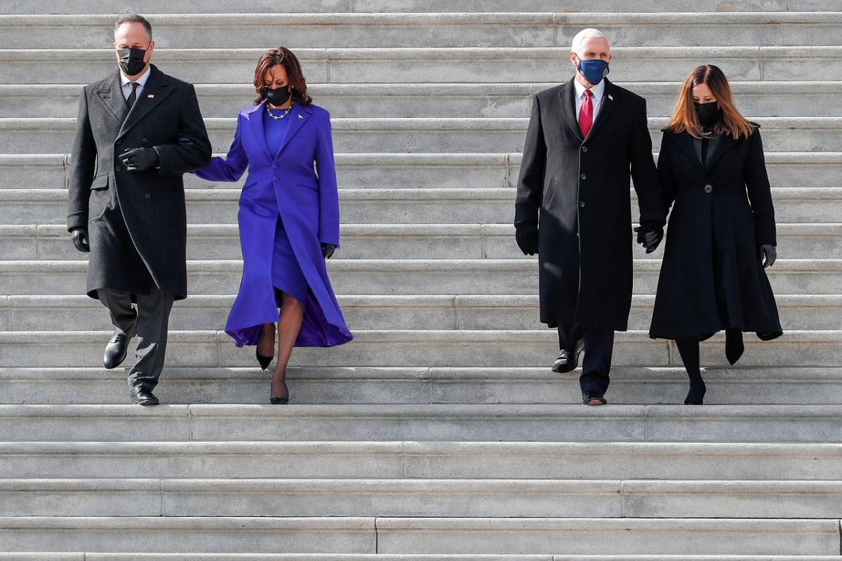 US Vice President Kamala Harris (second from left), with her husband Doug Emhoff, and former US Vice-President Mike Pence and his wife Karen leaving the inauguration ceremony.