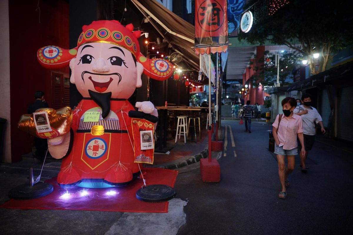 An inflatable God of Fortune at the festive bazaar in Chinatown on Jan 25, 2021.