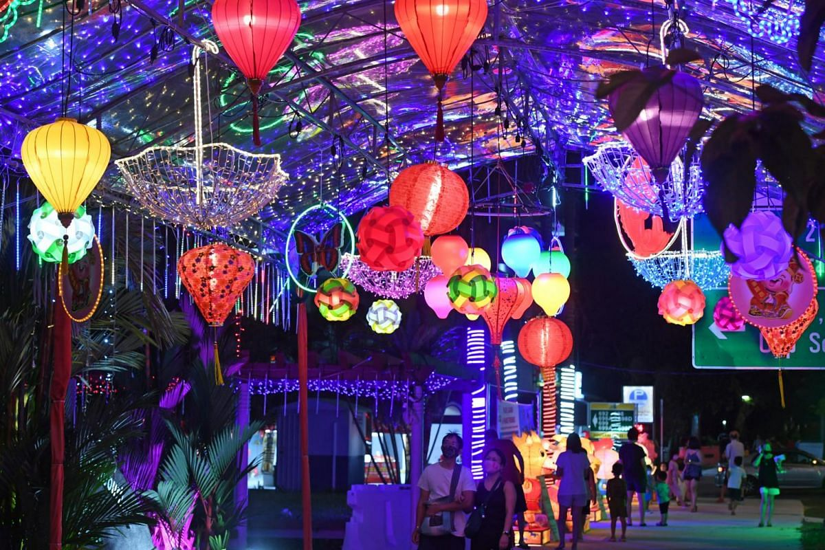 Members of the public look at a tentage with colourful Chinese lanterns as part of the Lunar New Year decorations at the junction of Hougang Ave 4 and Hougang Street 61 on Feb 5, 2021.