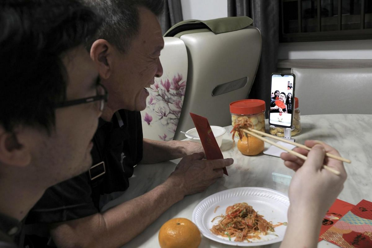 Mr Ong Hock Chwee having a virtual reunion dinner via video call with his wife Ong Lay Bee, son Benjamin and daughter Shane who are based in Johor Baru, alongside older son Benny.