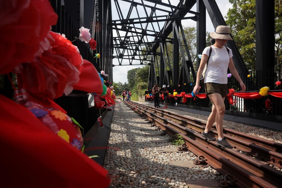 """Bukit Timah Truss Bridge is adorned with handmade lanterns and flowers """"upcycled"""" from materials such as used plastic bags and bottles by volunteers living in the Bukit Timah area."""