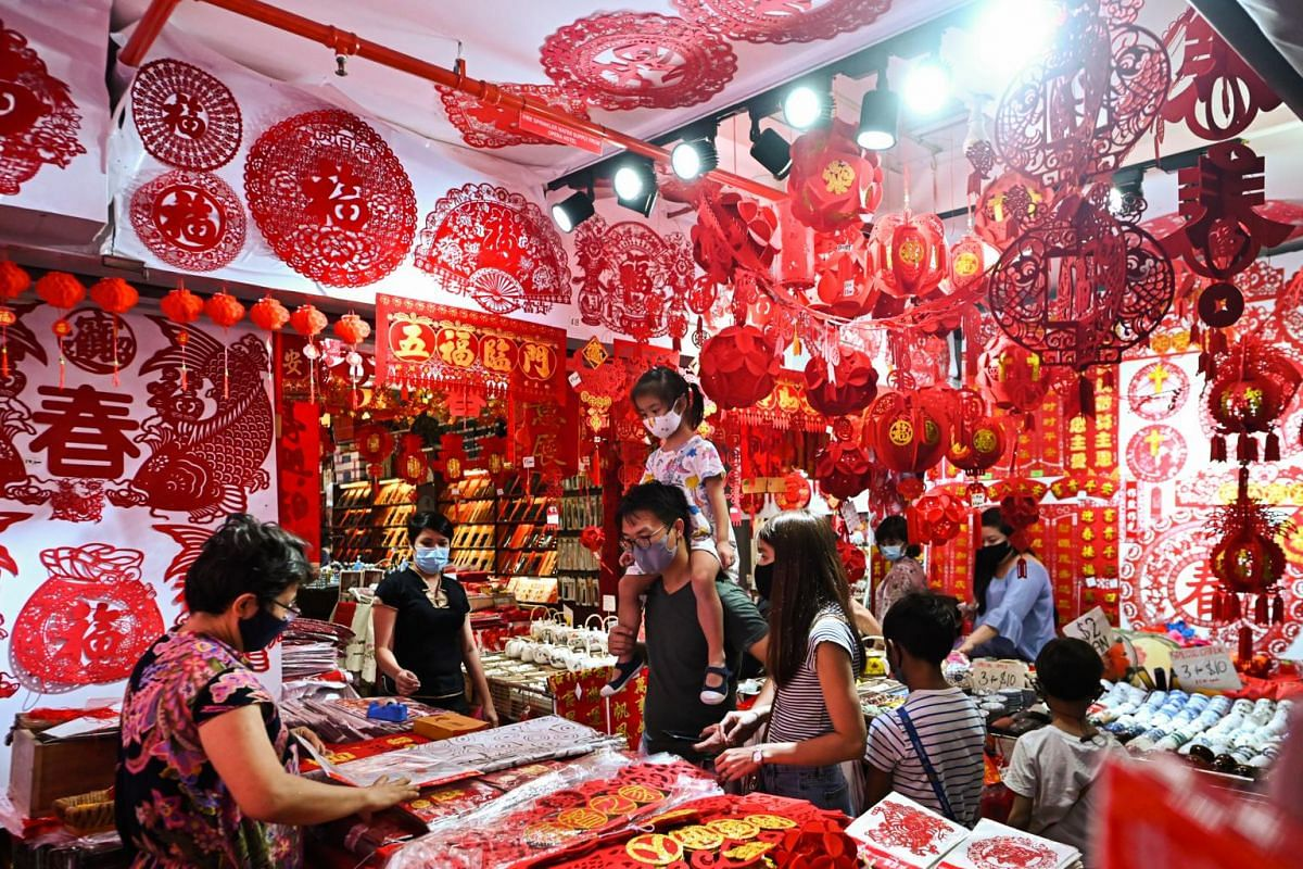 Customers at a shop in Chinatown that sells Chinese New Year decorations on Jan 30, 2021.