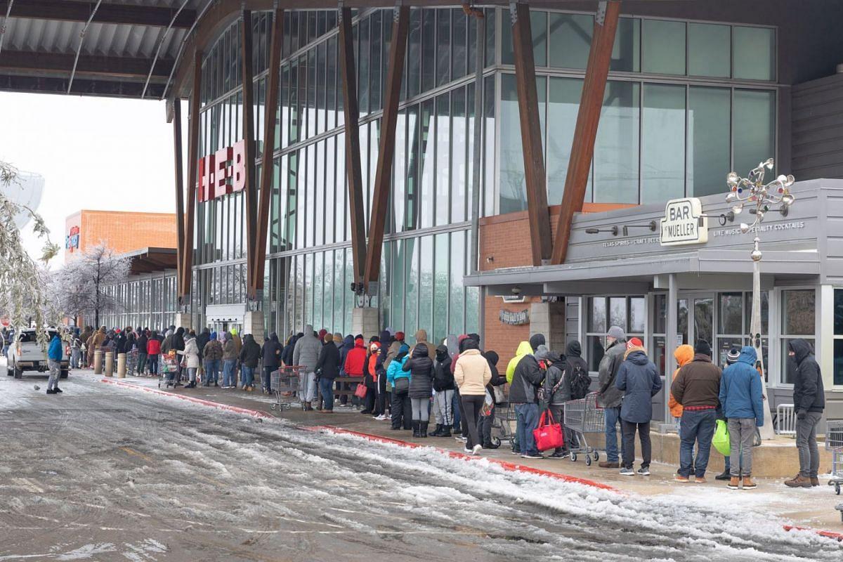 People wait in line outside a H-E-B grocery store in Austin, Texas, U.S., on Feb 17, 2021.