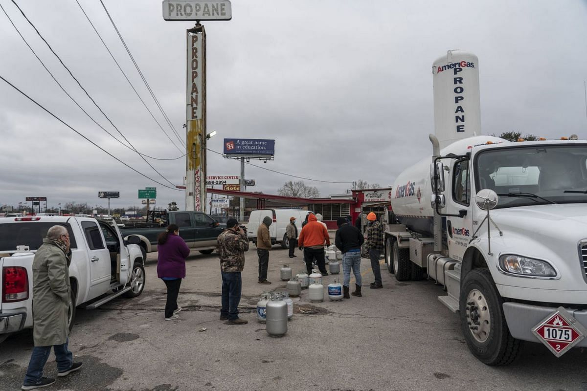 People line up at a propane gas station to refill their tanks after winter weather caused electricity blackouts on Feb 18, 2021 in Houston, Texas.