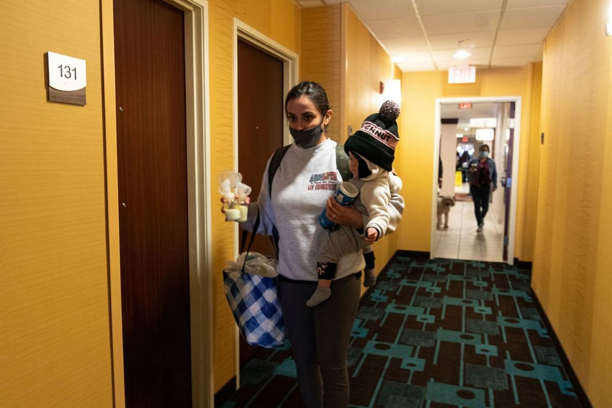 Francesca Khidre and her daughter Elena arrive at a hotel after losing power and water at their home in Austin, Texas, on Feb. 16, 2021.